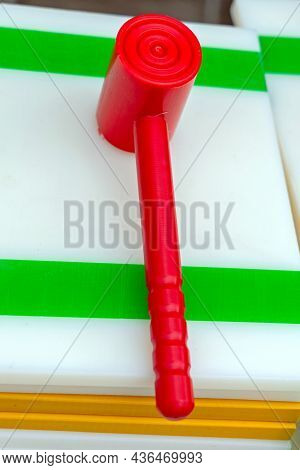 Red Plastic Mallet At Cutting Board Equipment