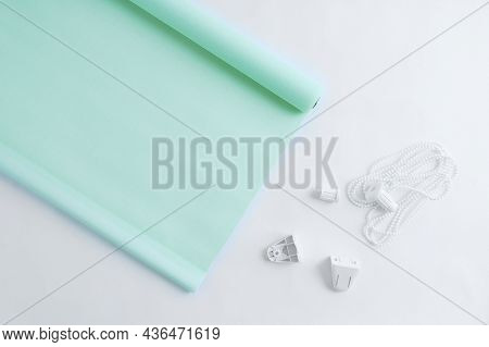 Green Roller Blinds For Window Blinds With Plastic Fastening On A White Background.