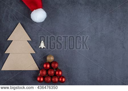 Creative Christmas Trees On A Dark Gray Background. Made Of Balls, Craft Paper And Wood. Christmas A