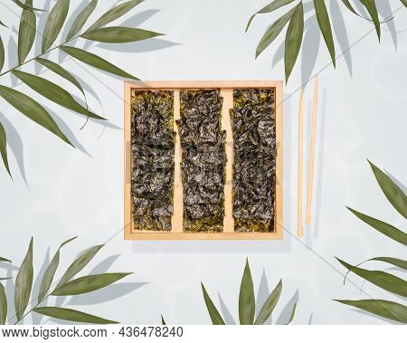 Healthy Sea Snack Suitable For Keto And Vegan Diet. Salty Dried Seaweed Snack On A Wood Board, Chops