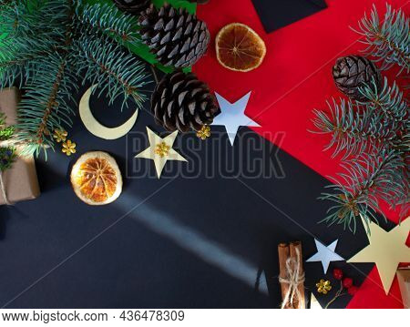 Christmas Composition On Red-black Background.christmas Gifts, Pine Cones, Christmas Decorations.