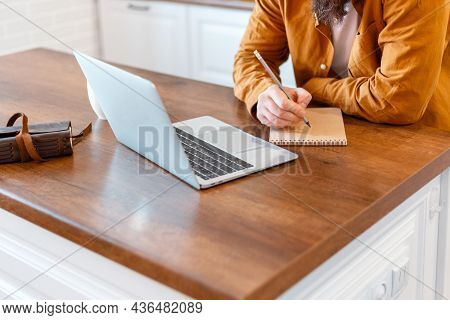 Man Do Paperwork Using Laptop For Online Work Education Or Working From Home. Close Up Male Hands Ma