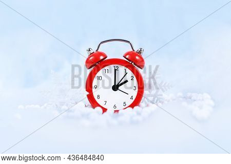 Winter Time Change For Daylight Saving In Europe On October 31st Concept With Red Alarm Clock Betwee