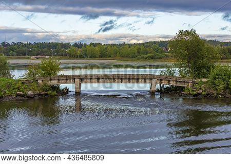 Rural Landscape With Narrow Stone Footbridge In Summer