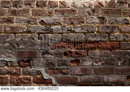 Red Brick Wall With Numerous Levels Of  Decay And Repair, Horizontal Aspect