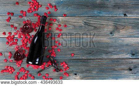 Valentines Day Holiday Background With A Bottle Of Wine, Drinking Glasses, Corkscrew Opener And Litt