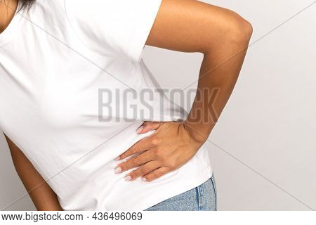 Pain In Side: Cropped Image Of Female Holding Hand On Left Under Ribs Suffer From Ache Or Colic. Fem