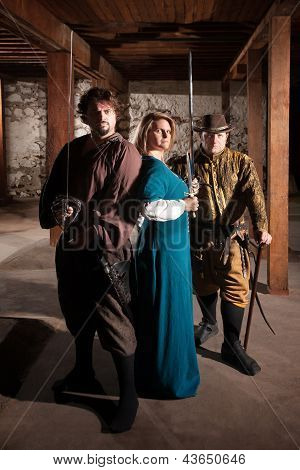 Three brave middle ages characters with swords poster