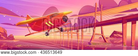 Small Airplane Flying At Sunset Ocean Landscape With Bridge. Crop Duster Plane Fly Over Sea Surface