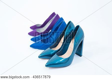 Three Pairs Of Blue Womens Shoes. High-heeled Shoes. One Pair Of Thin Heels, Stiletto Heels. The Sec