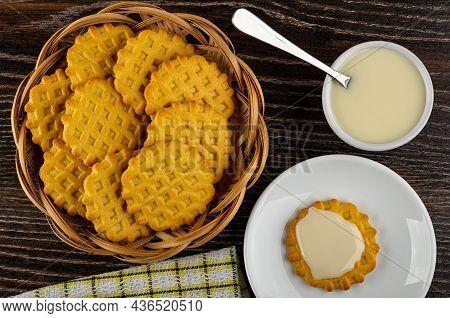 Waffle Cookies In Wicker Basket, Teaspoon In Bowl With Condensed Milk, Cookie Poured Condensed Milk