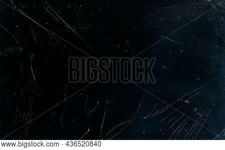 Broken Glass Texture. Dust Scratches Overlay. Fractured Laptop Screen. Grunge Dark Black Blue Damage