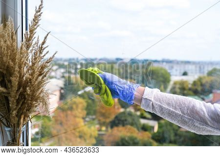 Employee Hand In Rubber Protective Glove With Micro Fiber Cloth Wiping Window From Dust. General Spr