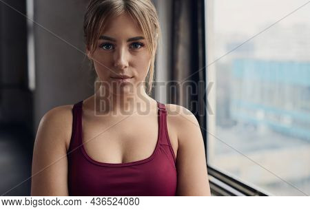 Crop Charming Young Female In Burgundy Wear With Blond Hair Looking At Camera In Daylight