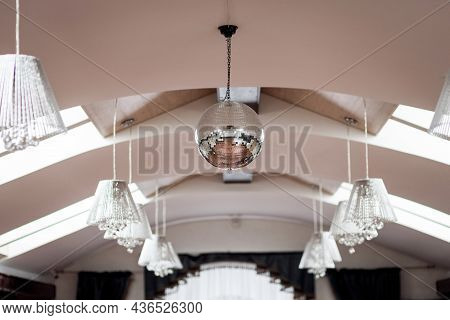 Disco Ball Hanging On Chainlet In Disco Club