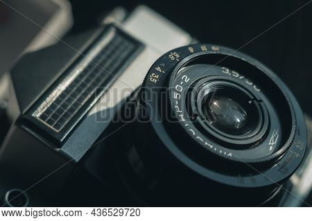 Close-up Of The Soviet Manual Lens Industar 50-2 On A Film Camera. Black Background, Copy Space, Dee