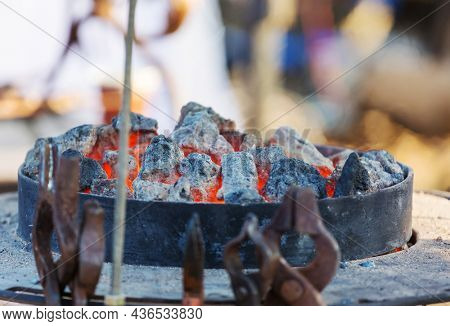 Old fashioned blacksmith furnace with burning coals