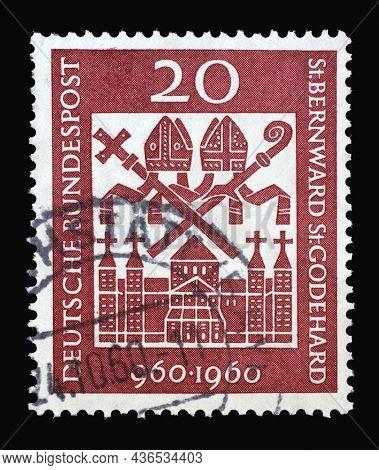 ZAGREB, CROATIA - JUNE 27, 2014: Stamp printed in Germany showing the Michaelskirche in Hildesheim and the bishop's regalia. Millenary of Bishops St. Bernward and St. Godehard, Hildesheim, circa 1960