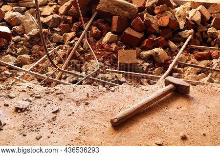 Dismantling, Disassembling The Floor. Smashed Concrete And Bricks Floor. Destroying Concrete Surface