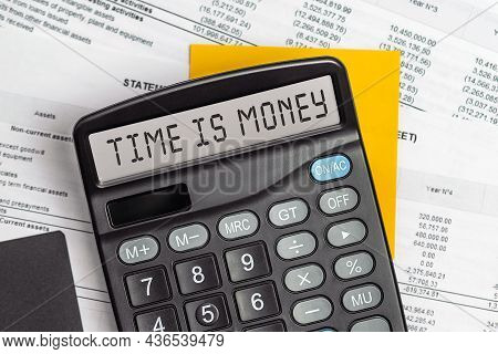 Time Is Money. On Display Of Calculator Is Written Time Is Money