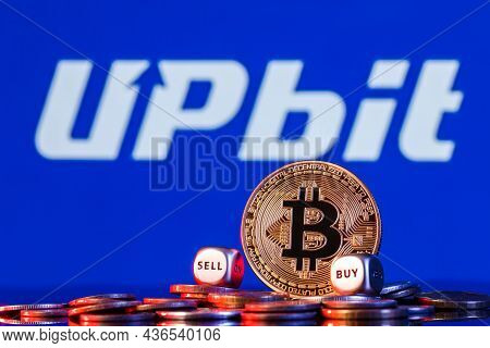 Kazan, Russia - Oct 15, 2021: Upbit Is Cryptocurrency Exchange. Golden Bitcoin With Two Buy-sell Cub