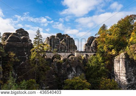 View To Rocks And Trees And The Bastion Bridge In The Saxon Sandstone Mountains, Germany.