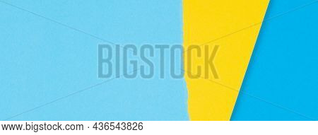 Torn Grunge Ripped Yellow Paper On Light Blue Color Paper Banner Background