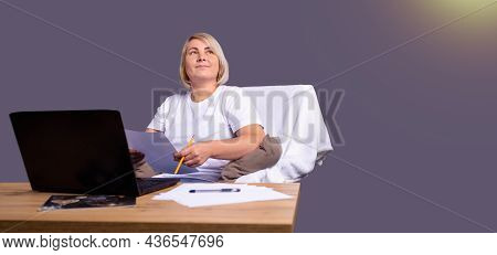 Banner On Ultimate Grey Background. Middle Aged Businesswoman Using Laptop Working On Pc Sitting In
