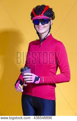 Female Cycling Ideas. Portrait Of Positive Female Road Cyclist In Professional Long Sleeve Jersey Wi