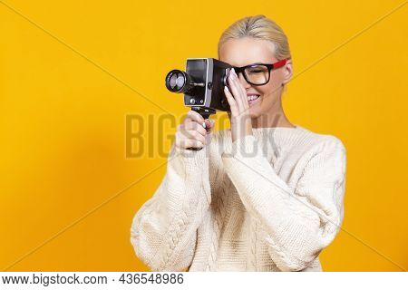 Smiling Caucasian Blond Girl Posing In Warm Wool Seater And Hipster Glasses While Holding Retro Film