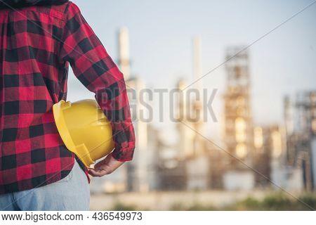 Refinery Woman Worker Oil Petro Industry Hand Hold Yellow Worker Helmet Hard Hat. Woman Worker Hands