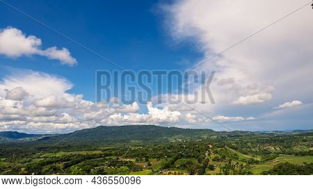Beautiful Landscape Mountain Green Field Grass Meadow White Cloud Blue Sky On Sunny Day. Majestic Gr