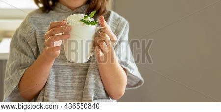 Indoor Photo Of Child Girl Holding Cake In A Mug, Baking At Home With Kids, Dessert Preparation.