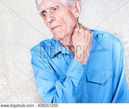 Old Man Suffering From Pain In Neck, Osteochondrosis. Male Hands Holding Neck. White Background