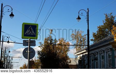 Pedestrian Crossing Sign Against The Sky, Road Safety Concept.pedestrian Transit Traffic Sign.pedest