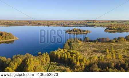Autumn Forest And Lake. View From The Top. Aerial Photo Of An Island In Lake On Sunny Autumn Day. Na
