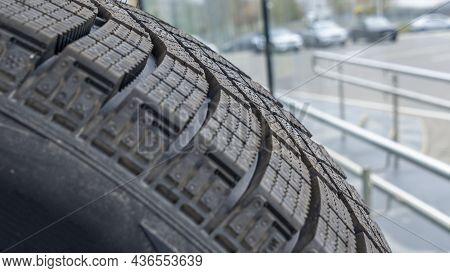 Close-up View Of The Winter Tread Of A New Tire In Shop. Automobile Tire For Snow Road. Selective Fo