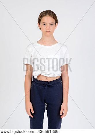 Young Girl In Blue Trousers And White T-shirt Model Snap Front Look Knee High On White Background
