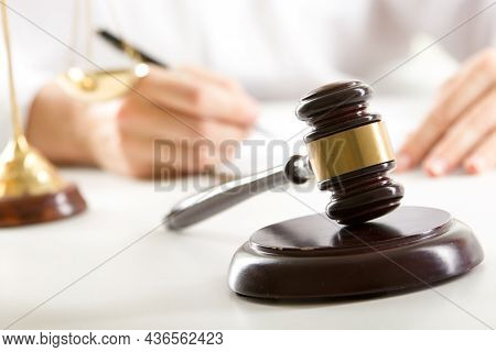 Lawyer Working With Contract Papers And Wooden Gavel On Tabel In Courtroom. Justice And Law , Attorn