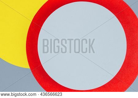 Blue Round Shape Platform Podium For Product Display On Red, Yellow And Gray Paper Background. Abstr