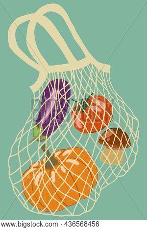 Eco Mesh Bag Full Of Vegetables Isolated On Blue Background. A Modern Shopper For Fresh Organic Prod