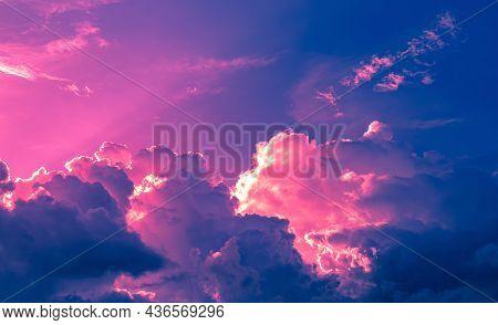 Red Purple Light On Dark Blue Clouds In Twilight Sky