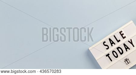 Creative Top View Flat Lay Composition. Sale Today Text On Lightbox On A Blue Background Copy Space.