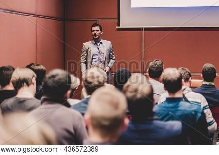 Speaker Giving A Talk At Business Meeting.