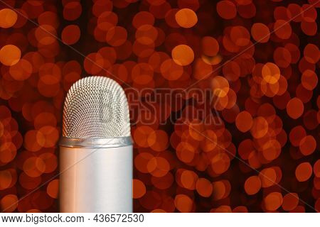 Retro Microphone On Stage With Bokeh Light Background. Close Up Of Mic In Concert Hall. Night Party
