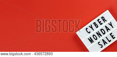 Cyber Monday Sale Text On Lightbox On A Red Background. Creative Top View Flat Lay Promotion Composi