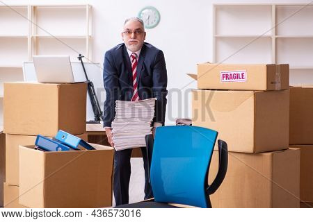 Old businessman employee in relocation concept