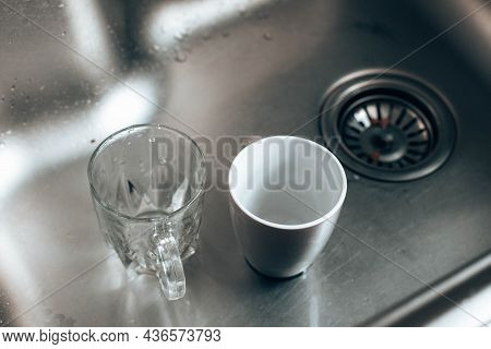 Dirty Glass And Ceramic Cups In The Sink, Washing Up