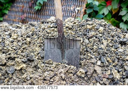 A Shovel For Digging The Earth Is Stuck In A Pile Of Soil
