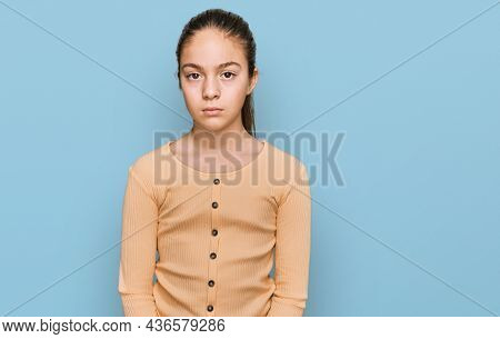 Beautiful brunette little girl wearing casual sweater skeptic and nervous, frowning upset because of problem. negative person.